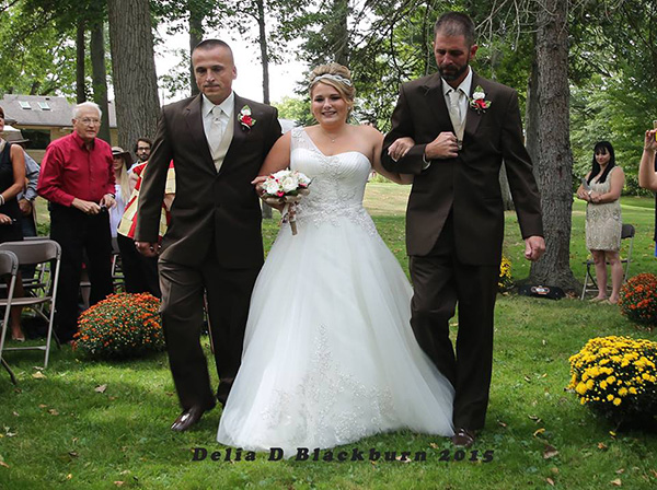 father of bride grabs father in law to walk her down aisle together