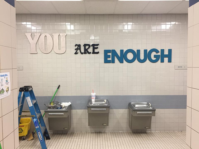 parents paint bathroom stalls inspirational messages