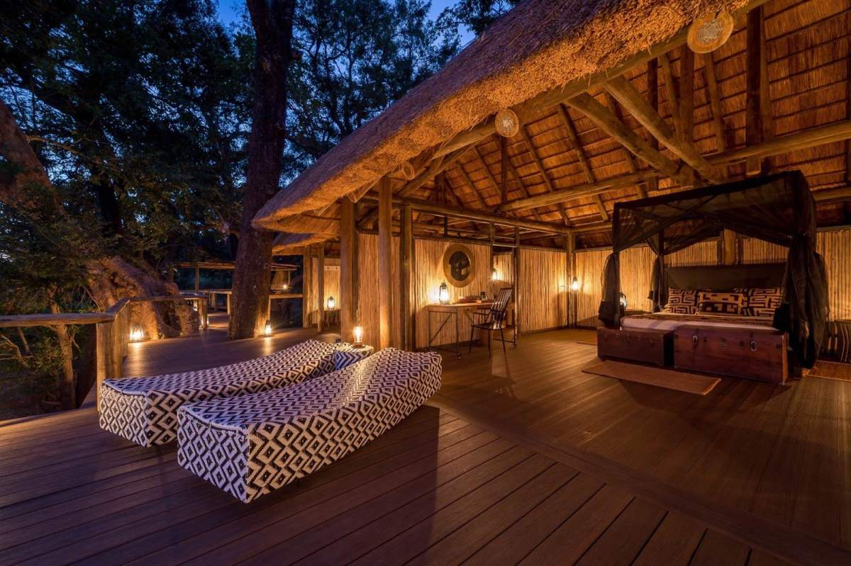 Romantically lit, open air bedroom at Chamilandu