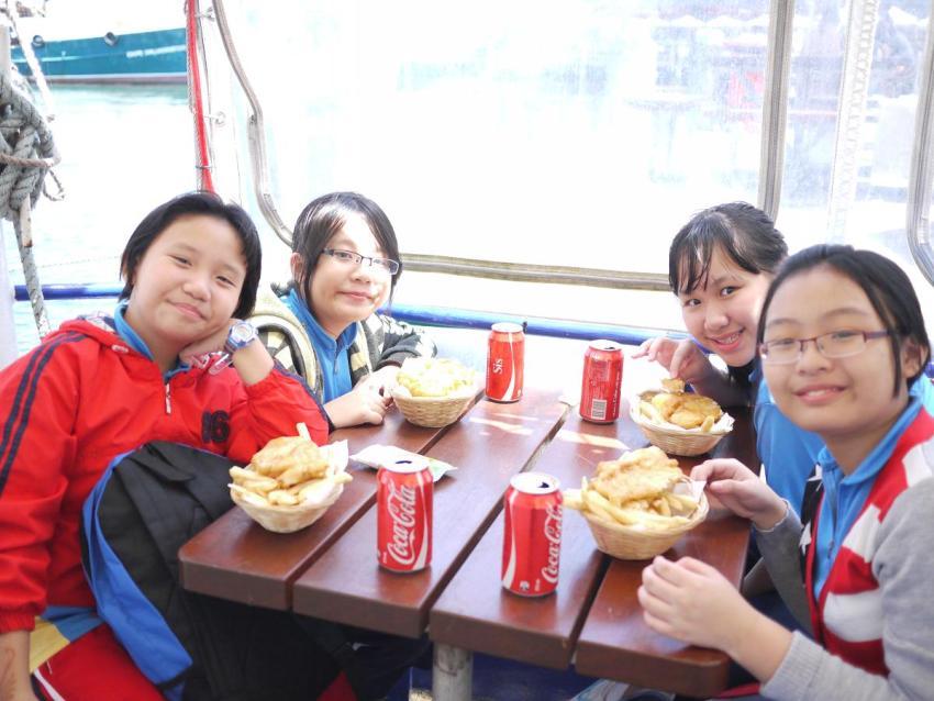 Children Enjoying Fish and Chips