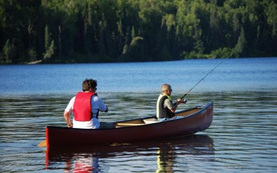 Fishing_from_canoe_on_lake