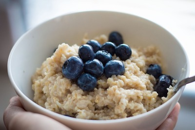 bowl of oatmeal with blueberries on top