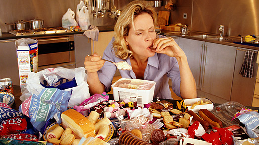 woman eating snack foods to deal with stress