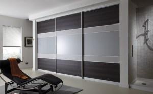 Fitted sliding wardrobes. Highland oak, metal, grey sliding doors