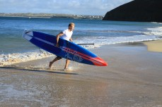 Ollie Shilston winning the SUP Distance Race at Carbis Bay