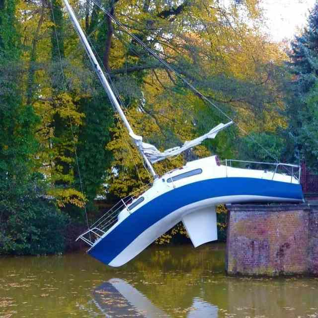 We have no idea how the sailbot ended on the wrong side of the river. It seems like the owner could have been drunk, consequently creating a new dock for the poor boat.