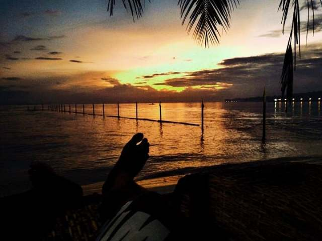 What is more perfect than watching the sun set while chilling on the beach? I guess the photo above sums it up.