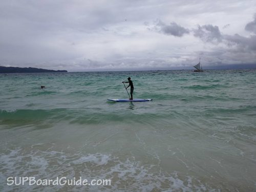 My instructor demonstrating the basics of SUP on choppy waters
