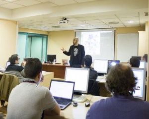 Professor teaching computer class