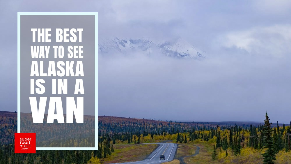 Fly to Alaska, rent a van, and drive around sleeping in the back.
