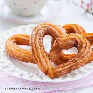 Surprise your loved one with these totally irresistible heart-shaped churros with chocolate sauce. Perfect for Valentine's day!