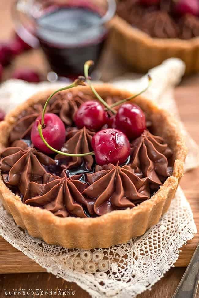 Yogurt chocolate mousse tart with tipsy cherries