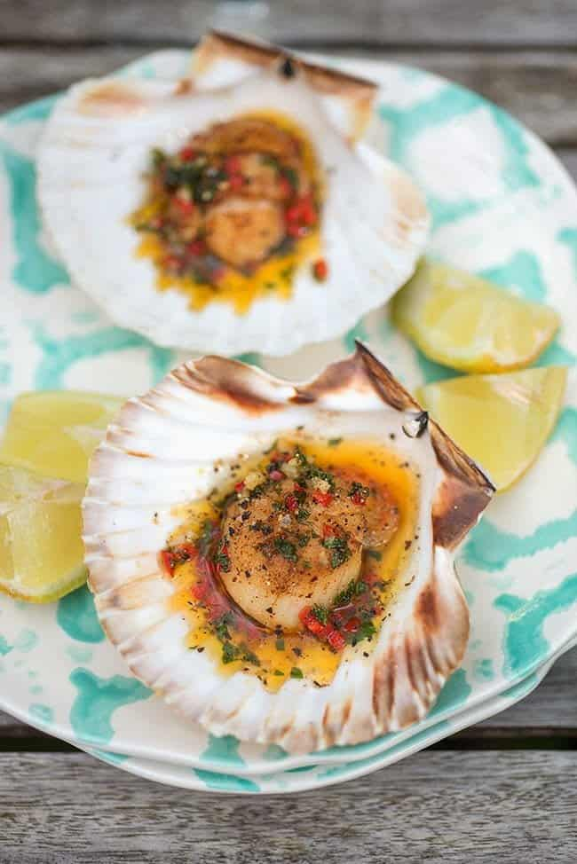 Scallops on the half shell with chilli clarified butter