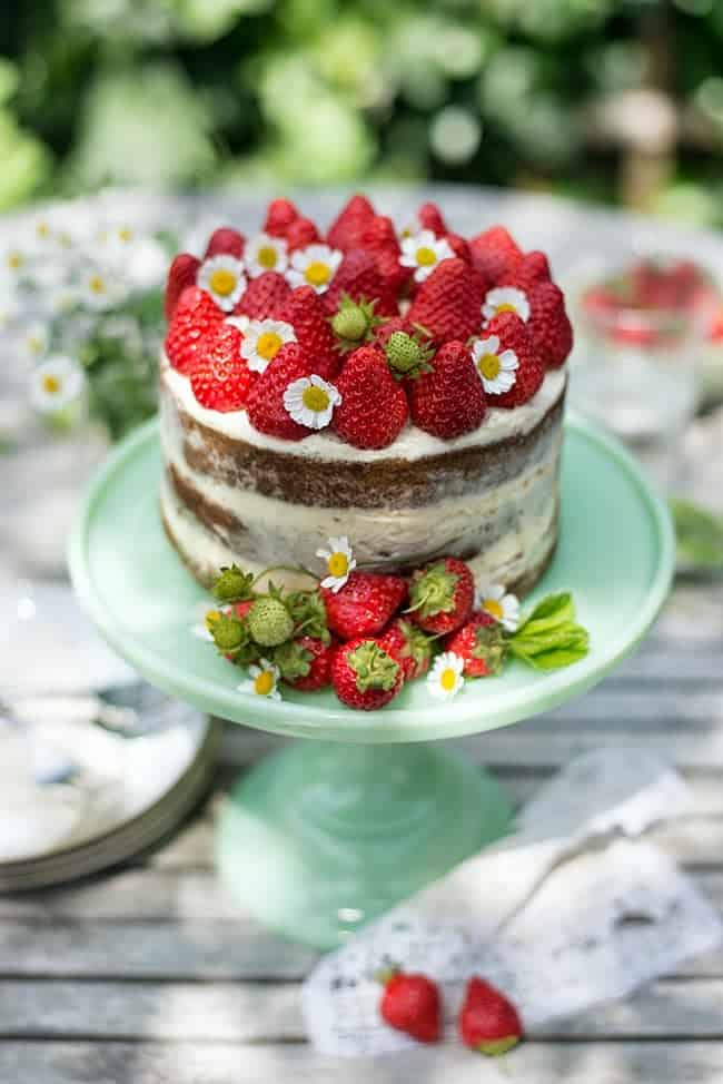 A spectacular strawberries and cream naked layer cake that