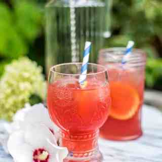This fruity tequila punch is perfect for summer parties and tastes equally refreshing without any alcohol.