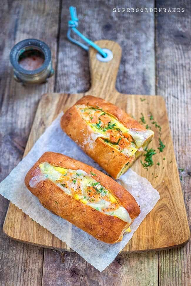 Baked egg boats with salmon and goat's cheese - perfect for breakfast or lunch.