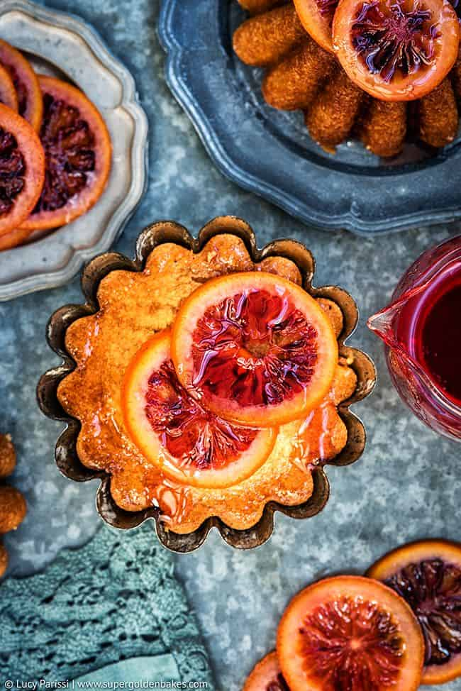 Olive oil and semolina syrup cakes with candied blood oranges