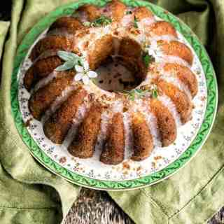 A gorgeously herb-scented lemon, thyme, ricotta and semolina cake soaked in hebal syrup and finished with a simple glaze. Perfect with a cup of herbal tea.
