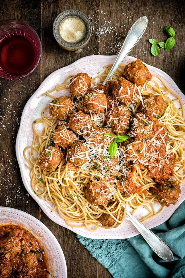 Slow cooker beef meatballs in tomato sauce served with spelt spaghetti