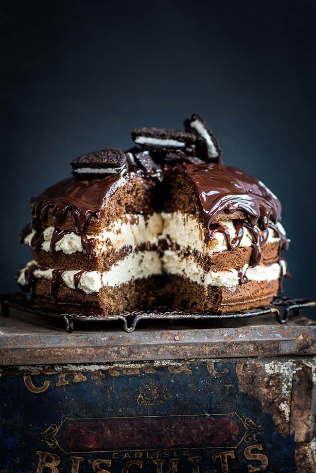 Cookies and cream layer cake topped with Oreo cookies