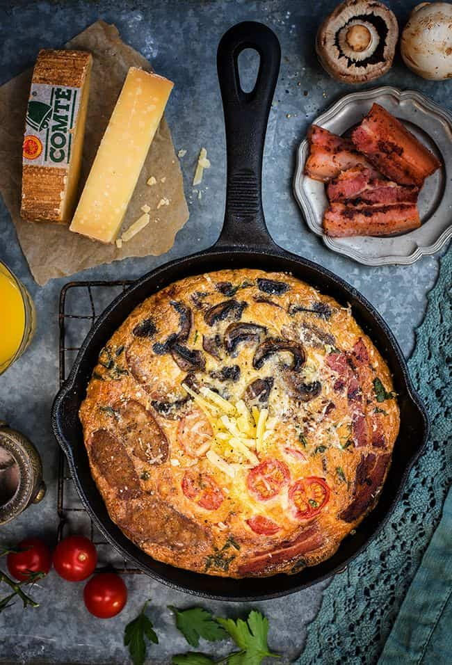 Fully Loaded Deep Dish Breakfast Frittata with Comté Cheese, Bacon, Sausages, Tomatoes and Mushrooms - perfect for brekfast, brunch or lunch.