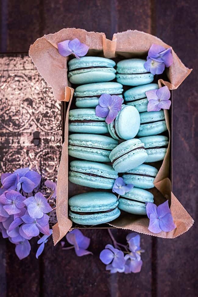 Vegan aquafaba macarons with avocado chocolate filling in a pretty box