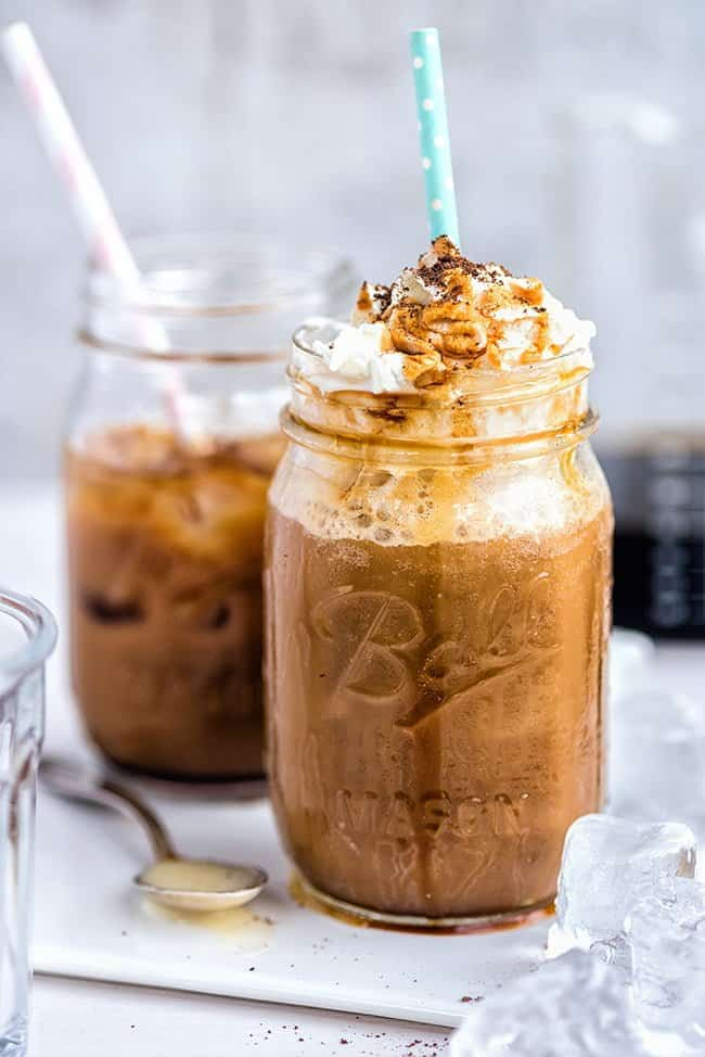 Vietnamese iced cold brew coffee with whipped cream and caramel