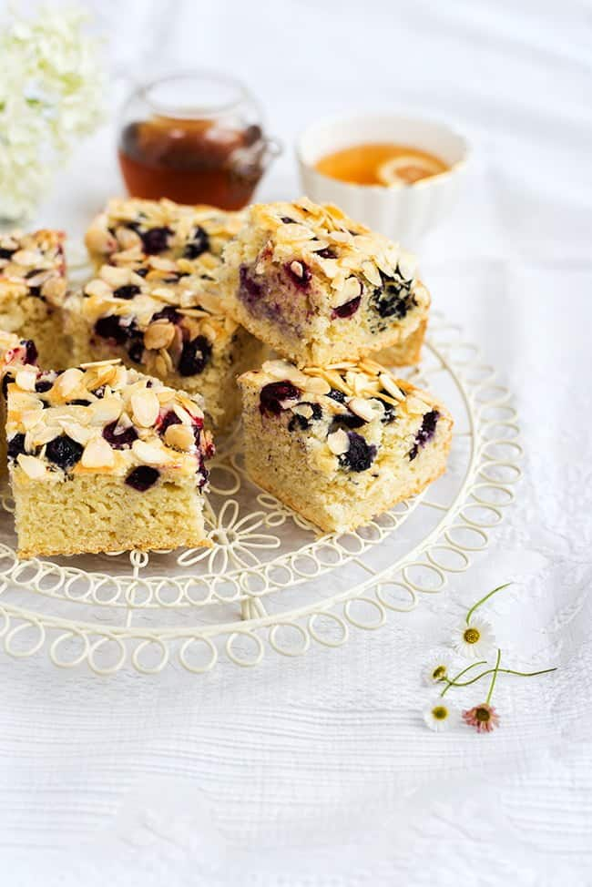 This blueberry and almond traybake is made with sugar substitute and a secret ingredient. Delicious and under 200 calories per slice.