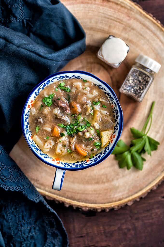 Hearty and delicious slow cooker beef and barley soup - the ultimate comfort food.