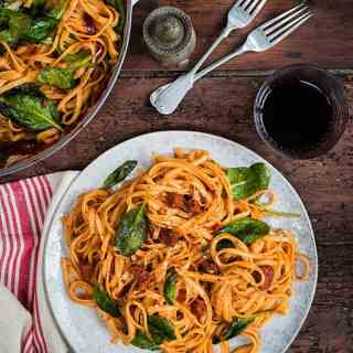 Spicy chorizo and tomato pasta with spinach. Ready in under 30 minutes.