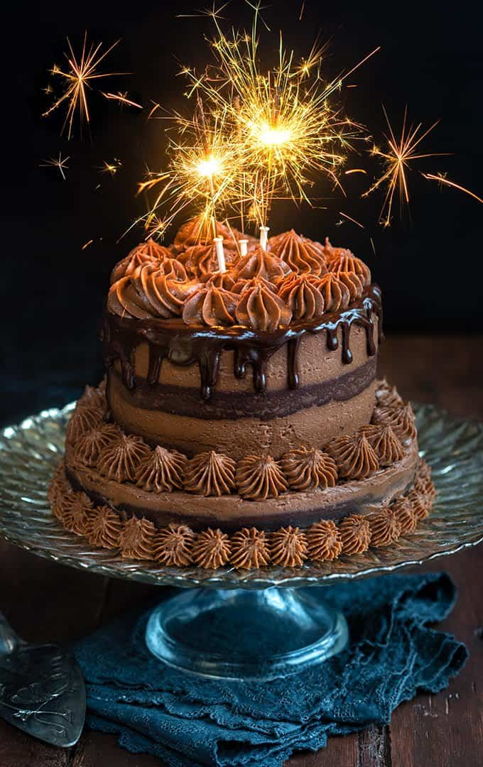 A towering festive chocolate pinata cake with chocolate, chestnut and mascarpone frosting and hidden silver coins to bring good luck to the new year!
