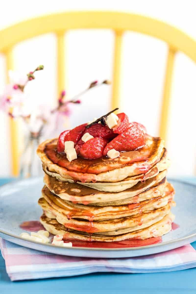 Fluffy white chocolate pancakes with roasted strawberries – a special indulgent treat for Pancake Day!