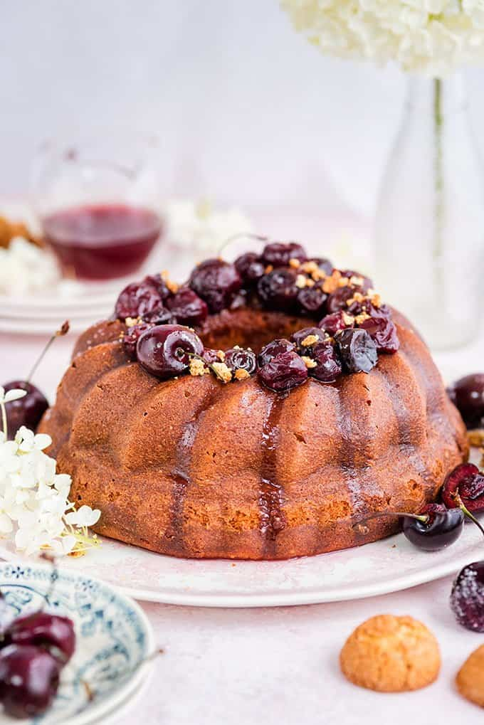 Amaretti ricotta semolina bundt cake with cherry compote – delicious served warm with a little crème fraîche on the side.