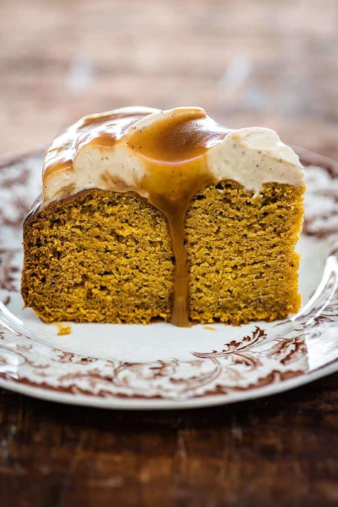 This pumpkin spice cake requires no mixer and only one bowl! Top with cream cheese frosting and toffee drizzle and watch it disappear fast…