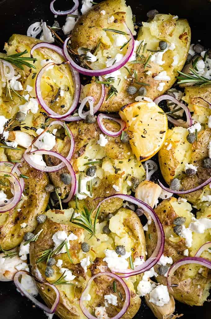 Greek smashed potatoes with feta cheese, rosemary, garlic, capers and onions