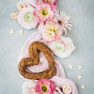 Heart-shaped churro arranged with fresh flowers