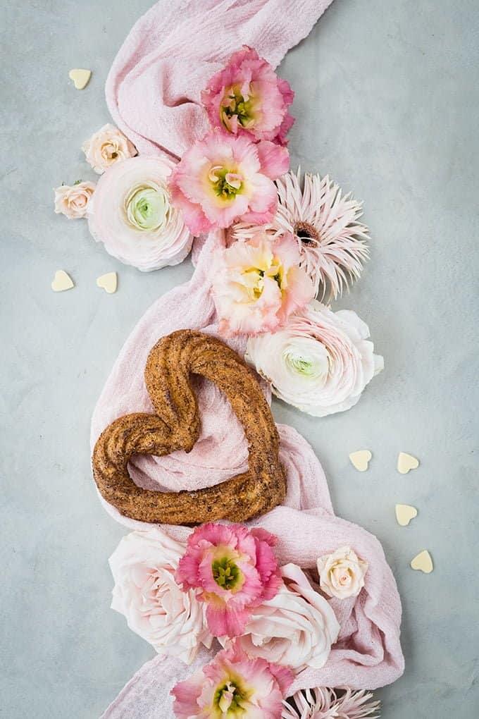 Heart-shaped churro arranged with fresh flowers