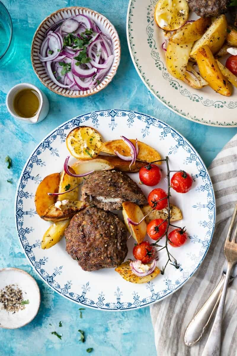 Greek bifteki with potatoes and tomatoes