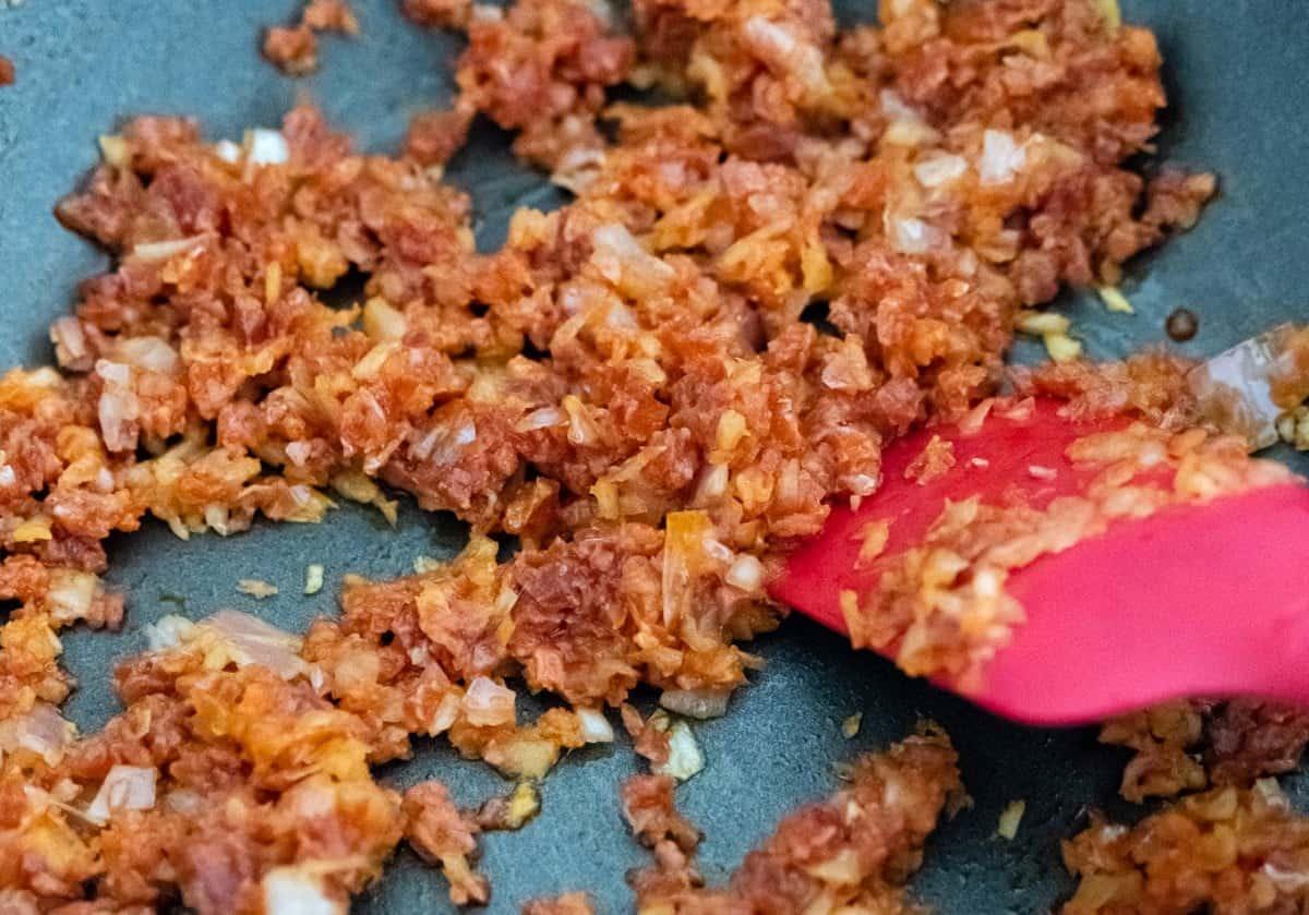 Frying chorizo for savoury churros
