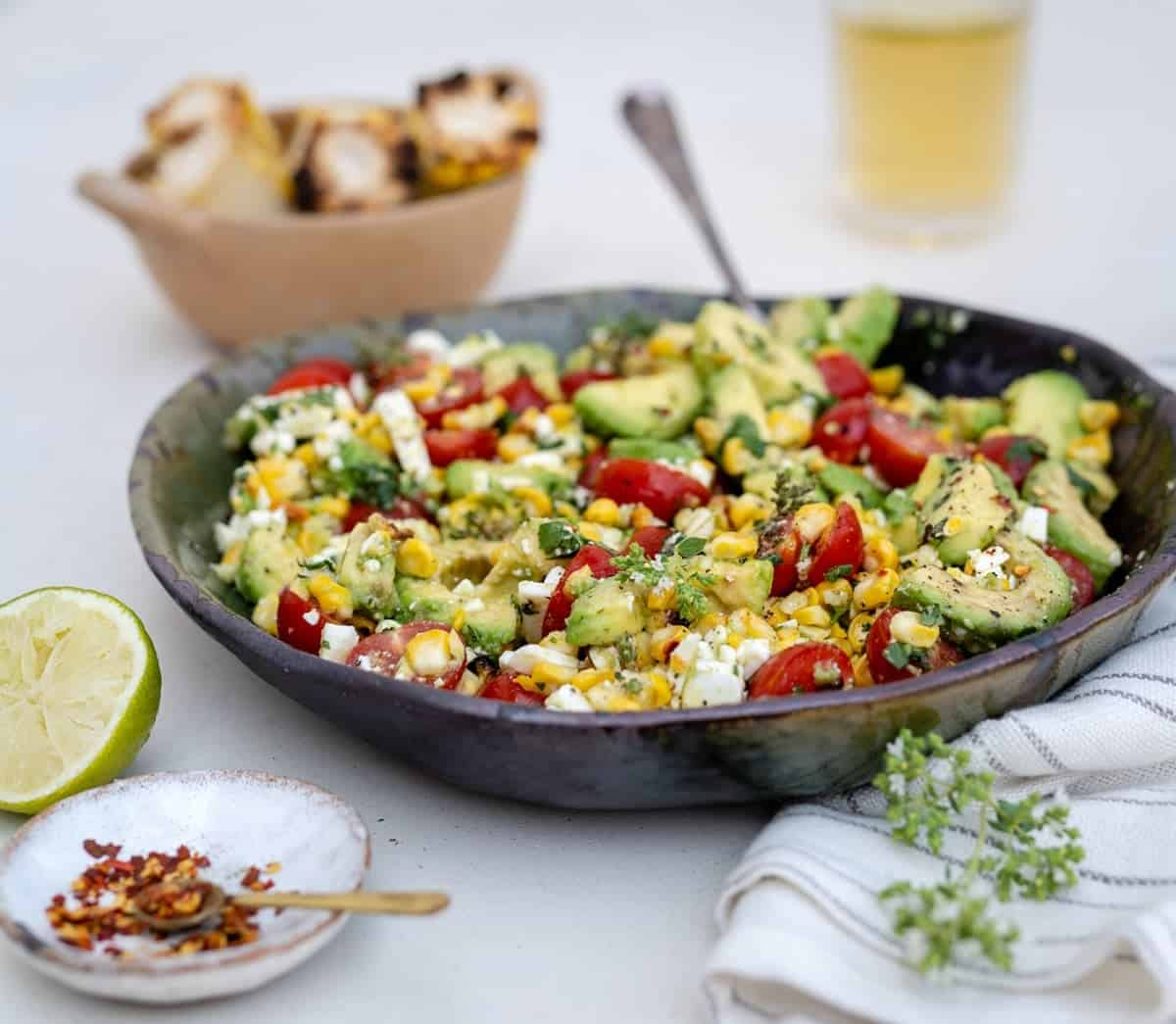 Grilled corn and avocado salad in a bowl