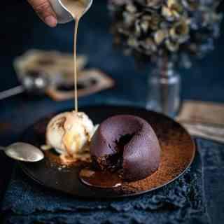 Molten chocolate lava cakes served with vanilla ice cream