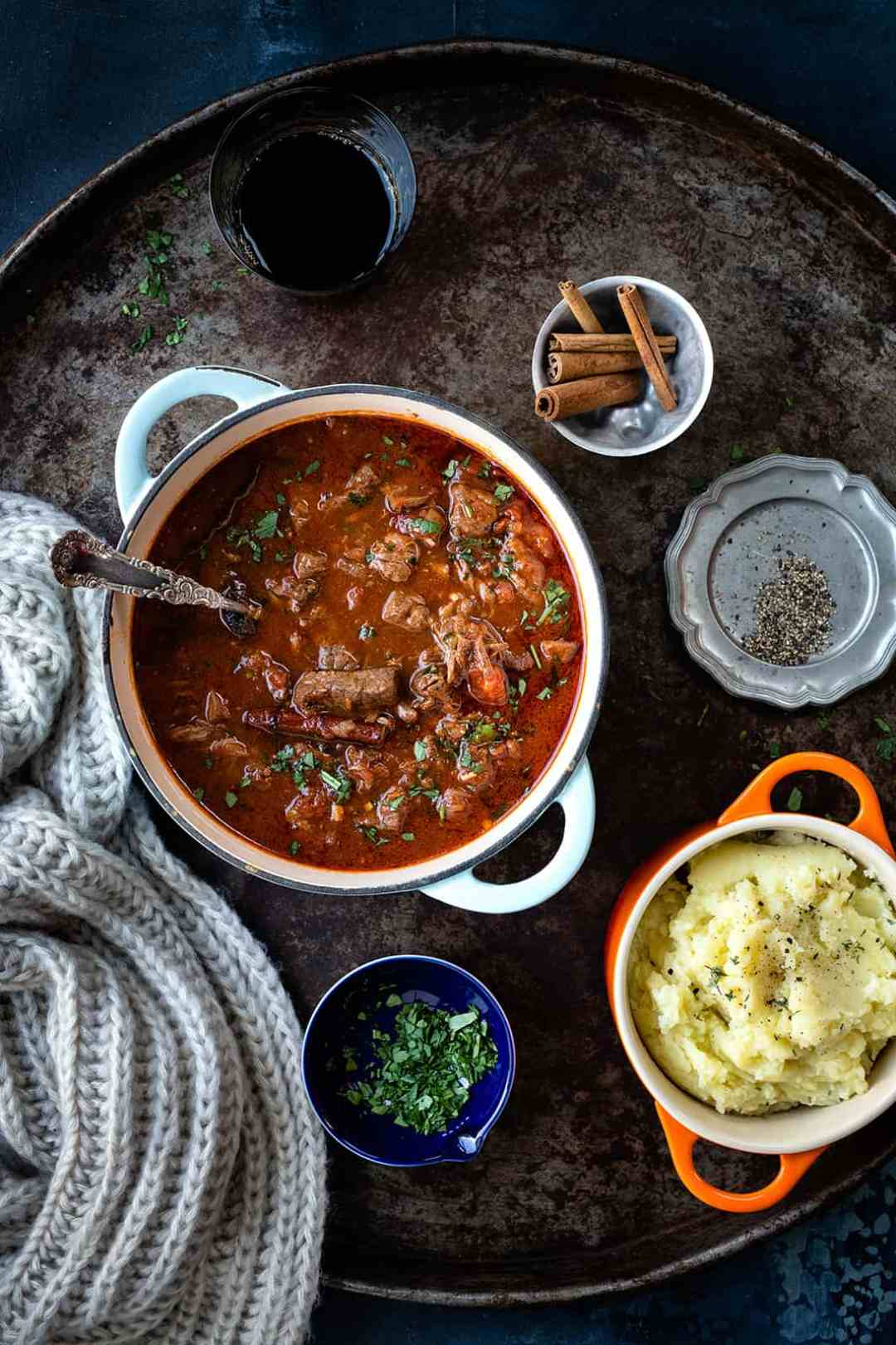 Kokinisto – Greek beef stew in a clay pot with mashed potatoes on the side