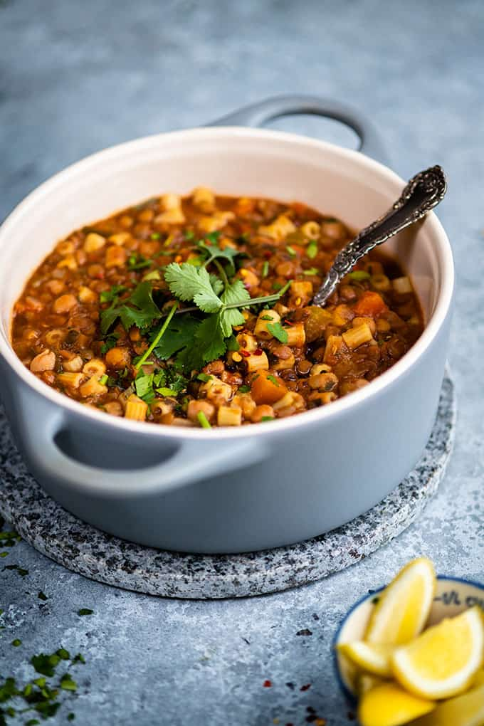 Pot of Morrocan Harira soup topped with coriander