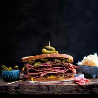 Pastrami sandwich with rye bread and pickles