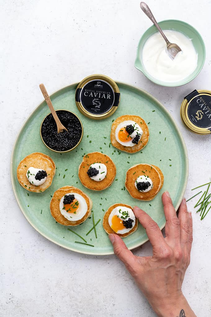 Blini canapés with caviar and sour cream