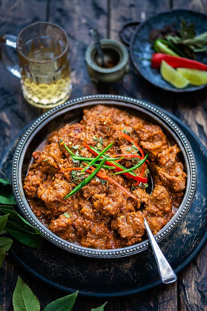 Large bowl of bhuna gosht curry on a dark background