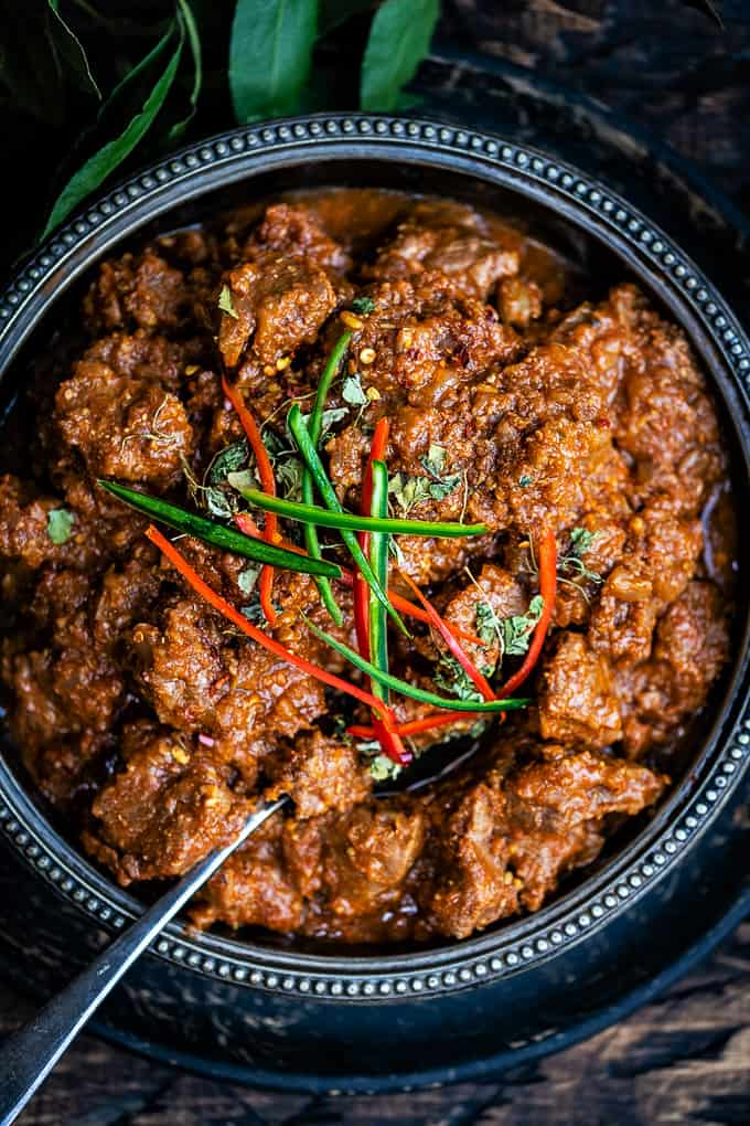 Close up on Lamb Bhuna curry garnished with sliced chillies
