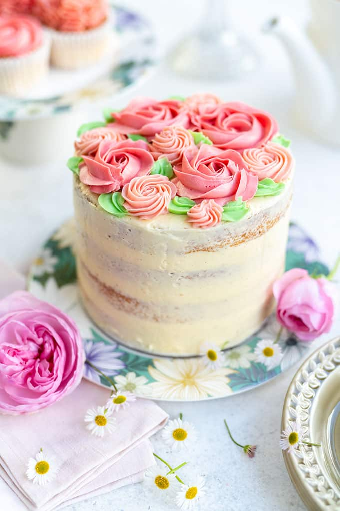 Pink ombre layer cake decorated with pink buttercream roses