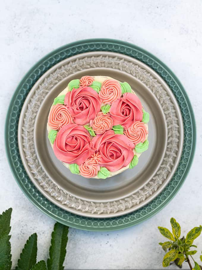 Buttercream decorations on top of a layer cake
