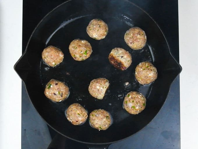 Frying meatballs in a skillet
